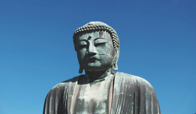 The Great Buddha in Kamakura, Kapan against a bright blue sky
