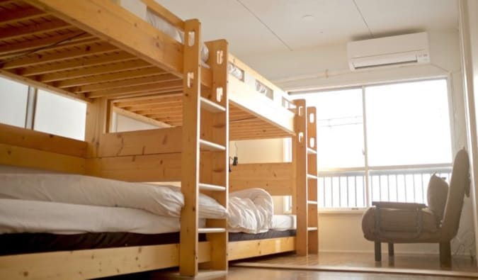 The comfy bunk beds in a dorm room at Hostel Chapter Two in Tokyo, Japan