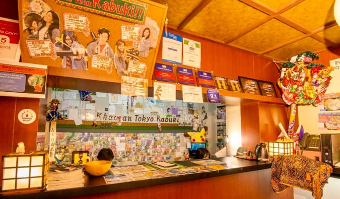 The electic and colorful check-in desk at Khaosan Tokyo Kabuki hostel in Tokyo, Japan