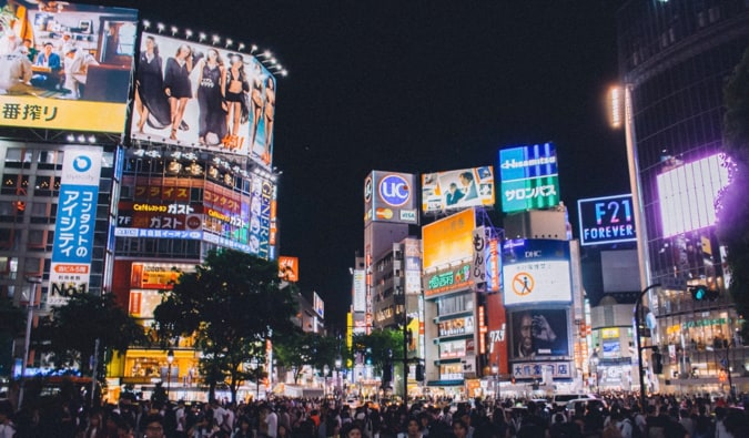 The busy Shibuya intersection in Tokyo, Japan at night