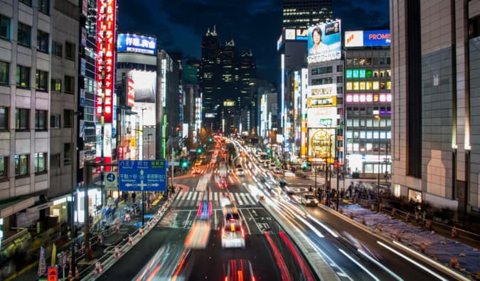 the bright signs and busy streets of Tokyo at night
