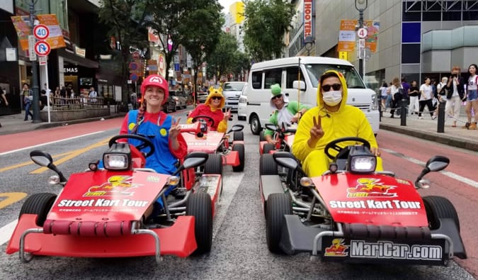 A group of travelers in go-karts in downtown Tokyo, Japan