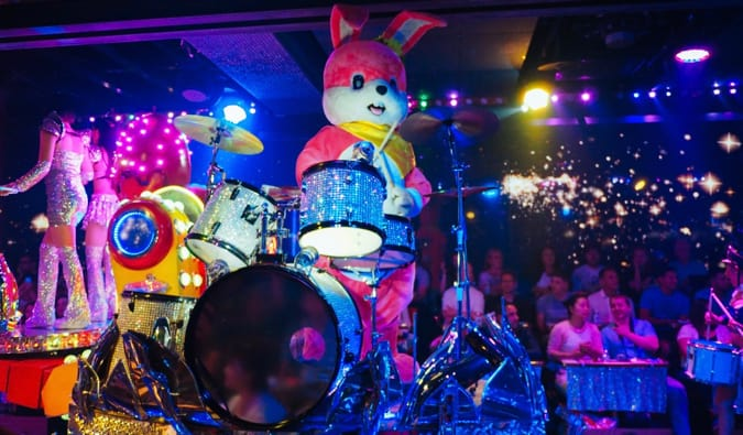 A musician dressed up as a rabbit playing the drums in the Robot Restaurant in Tokyo, Japan