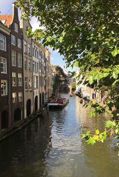 boats cruising along the old canal in Utrecht