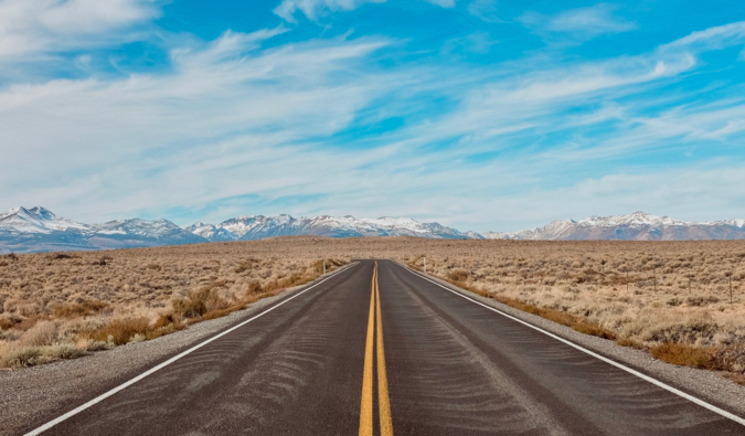 An open road and a blue sky on a road trip in the USA