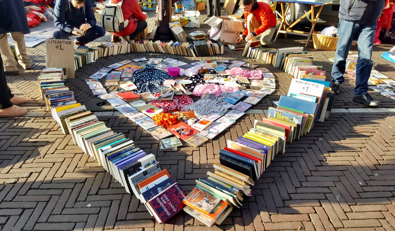 Books and clothing for sale at the Waterlooplein Flea Market in Amsterdam, Netherlands
