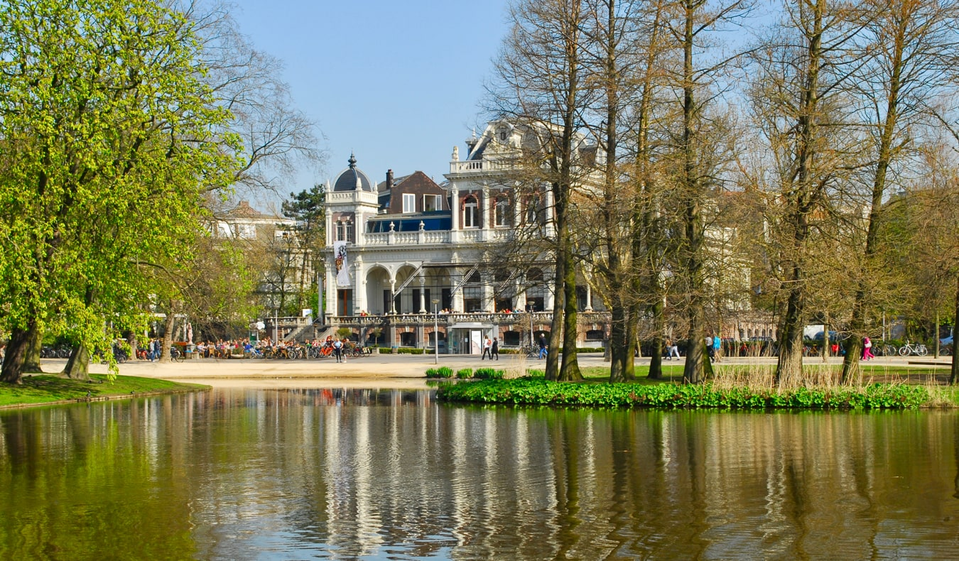 A small pond and an old building Vondelkpark, Amsterdam, Netherlands in the summer