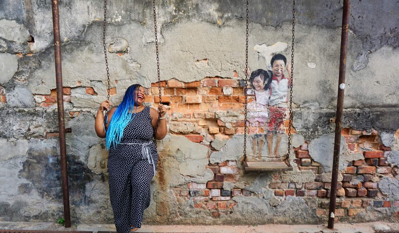 Annette posing near a mural in Penang
