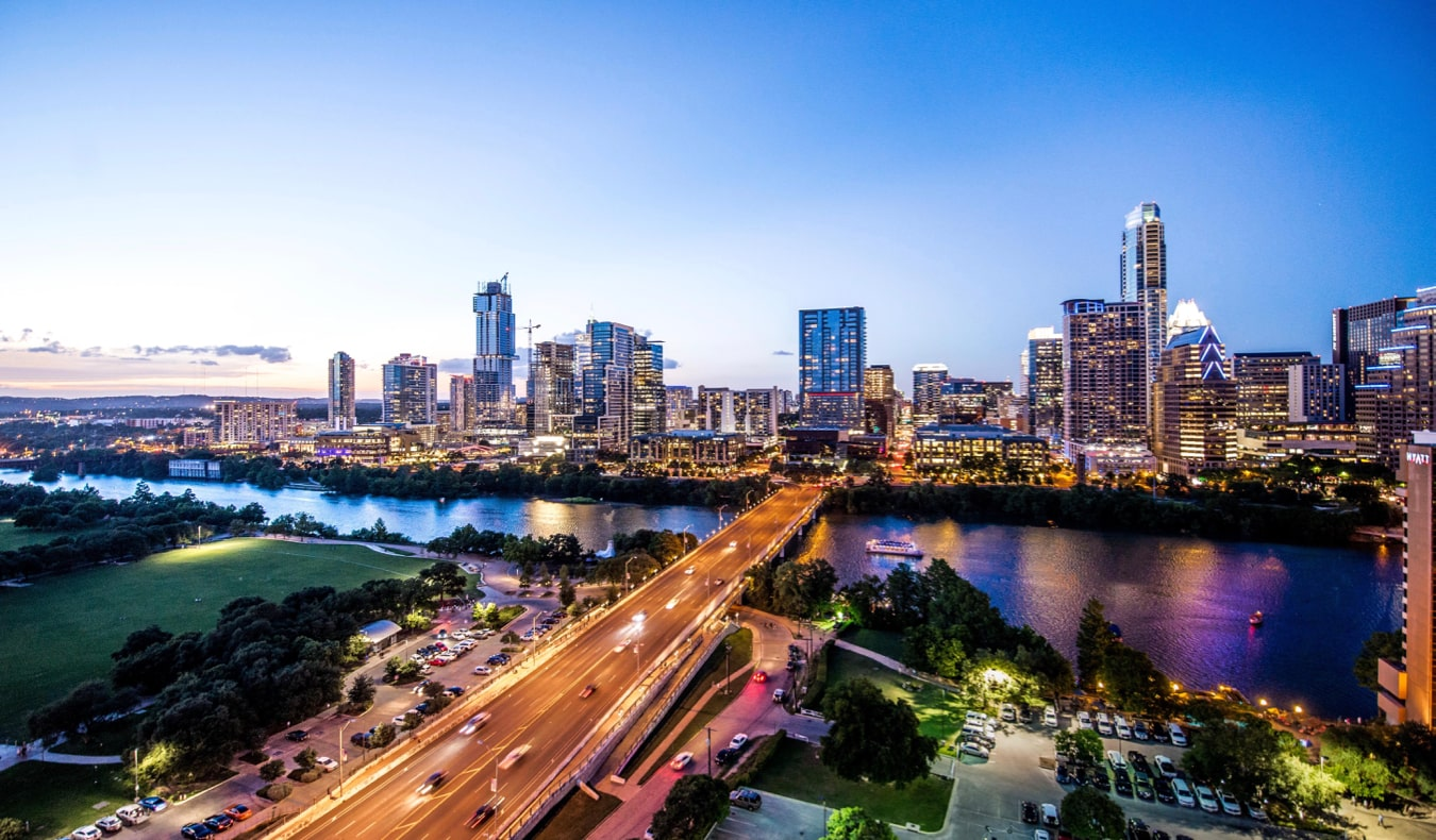 the busy skyline of Austin, Texas lit up at night