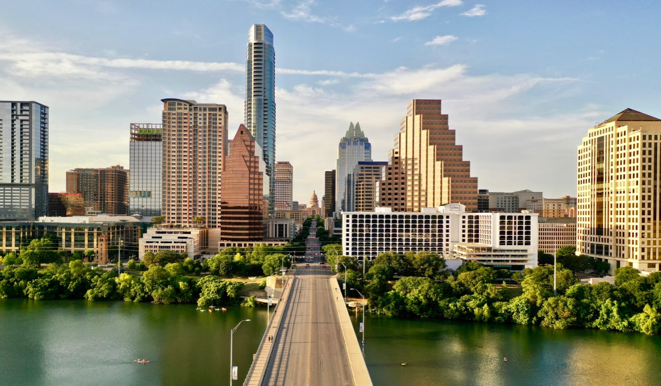 The towering skyline of Austin, Texas as seen from over a bridge