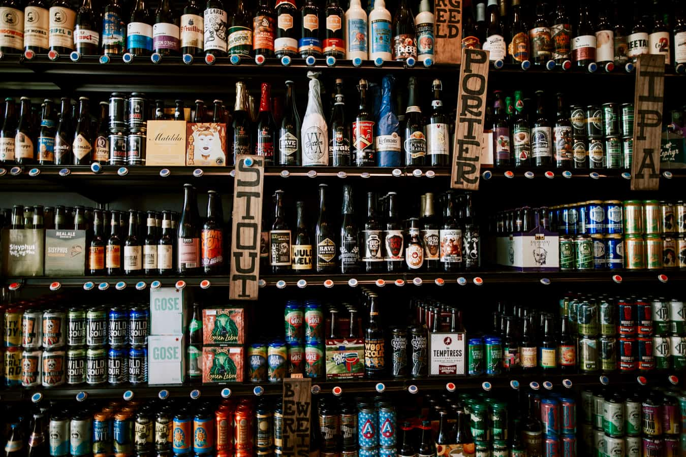 A wall of beers and alcoholic drinks at a bar in Austin, Texas