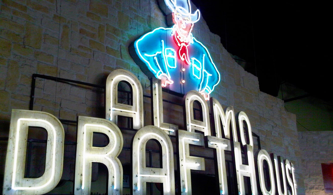 The bright electric sign of the Alamo Drafthouse in Austin, Texas