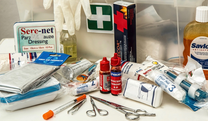 Medicine and supplies in a first aid kit