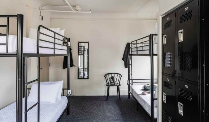 A clean and comfortable dorm room with lockers in the Boston Fenway Inn