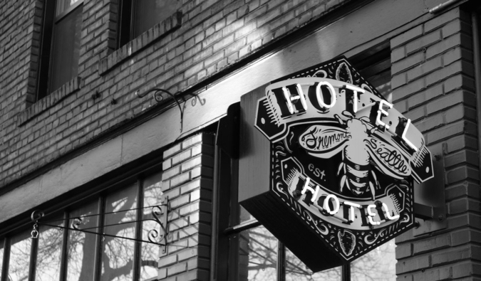 A black and white photo of the exterior of the HotelHotel hostel in Seattle