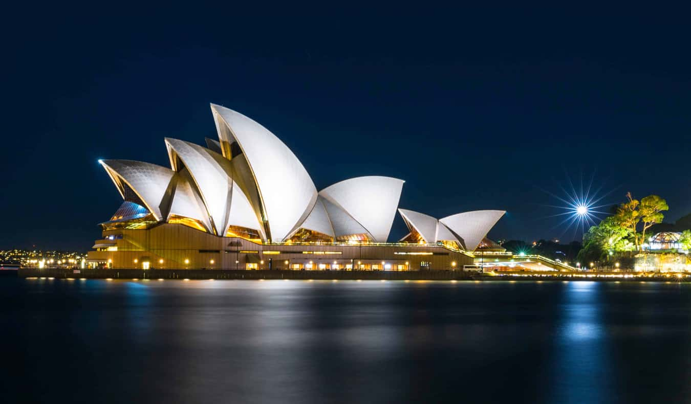 A long-exposure shot of the Sydney Opera House at night