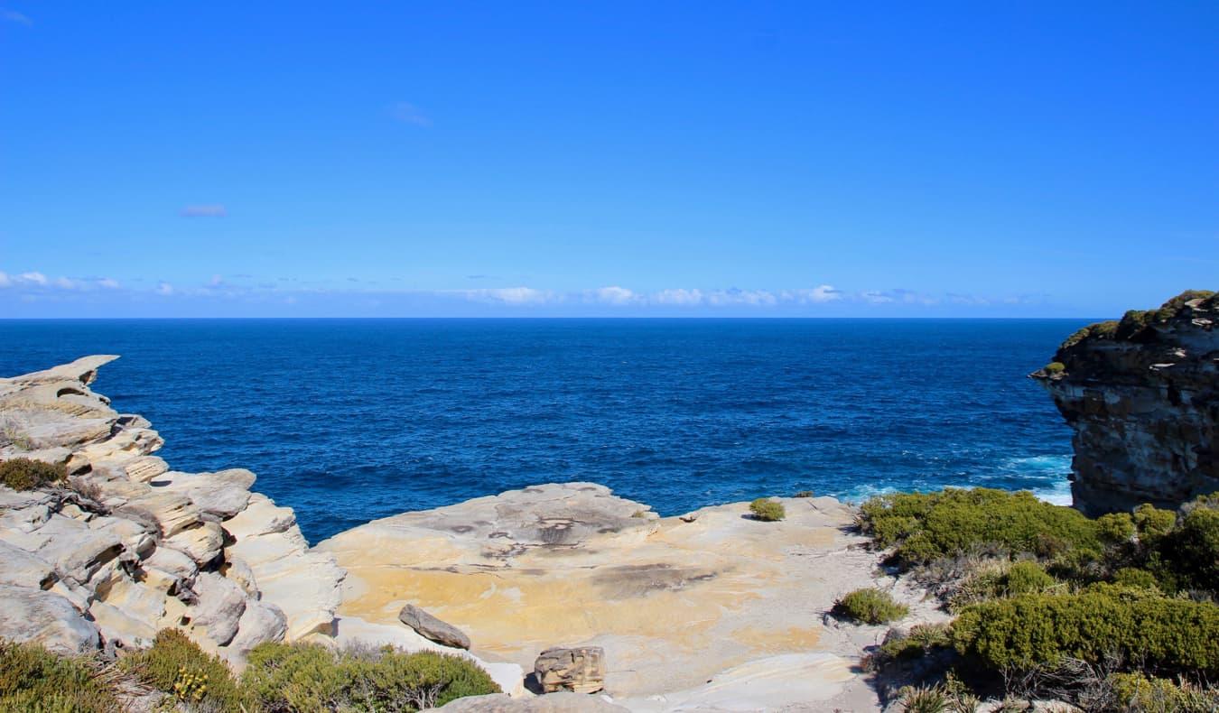 Hiking along the rugged coastline of Sydney, Australia