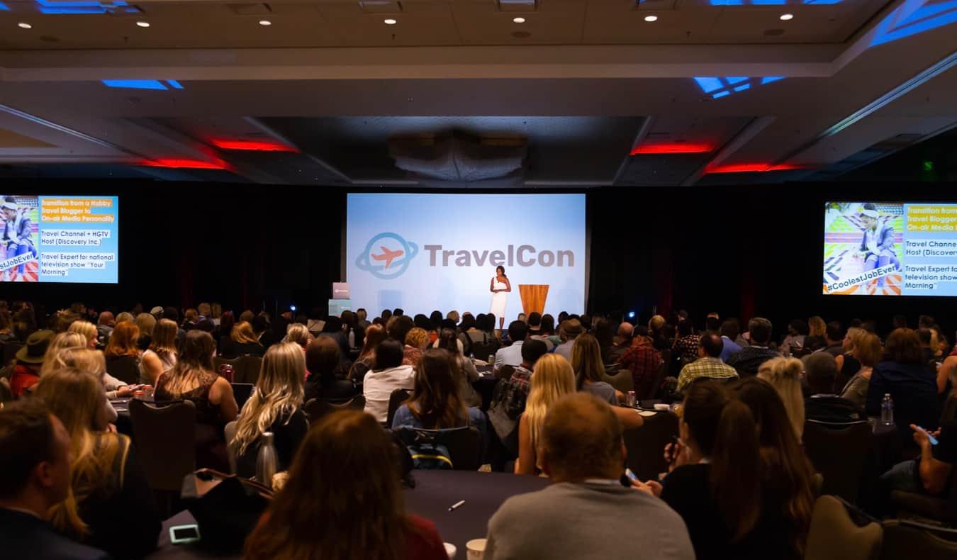 Oneika Raymond speaking at TravelCon
