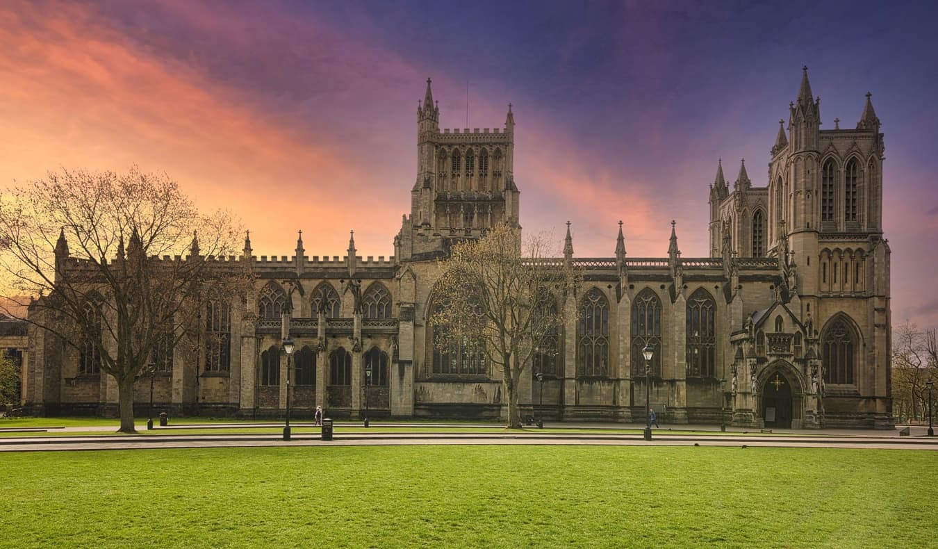 The historic exterior of the Bristol Cathedral in Bristol, UK during sunset