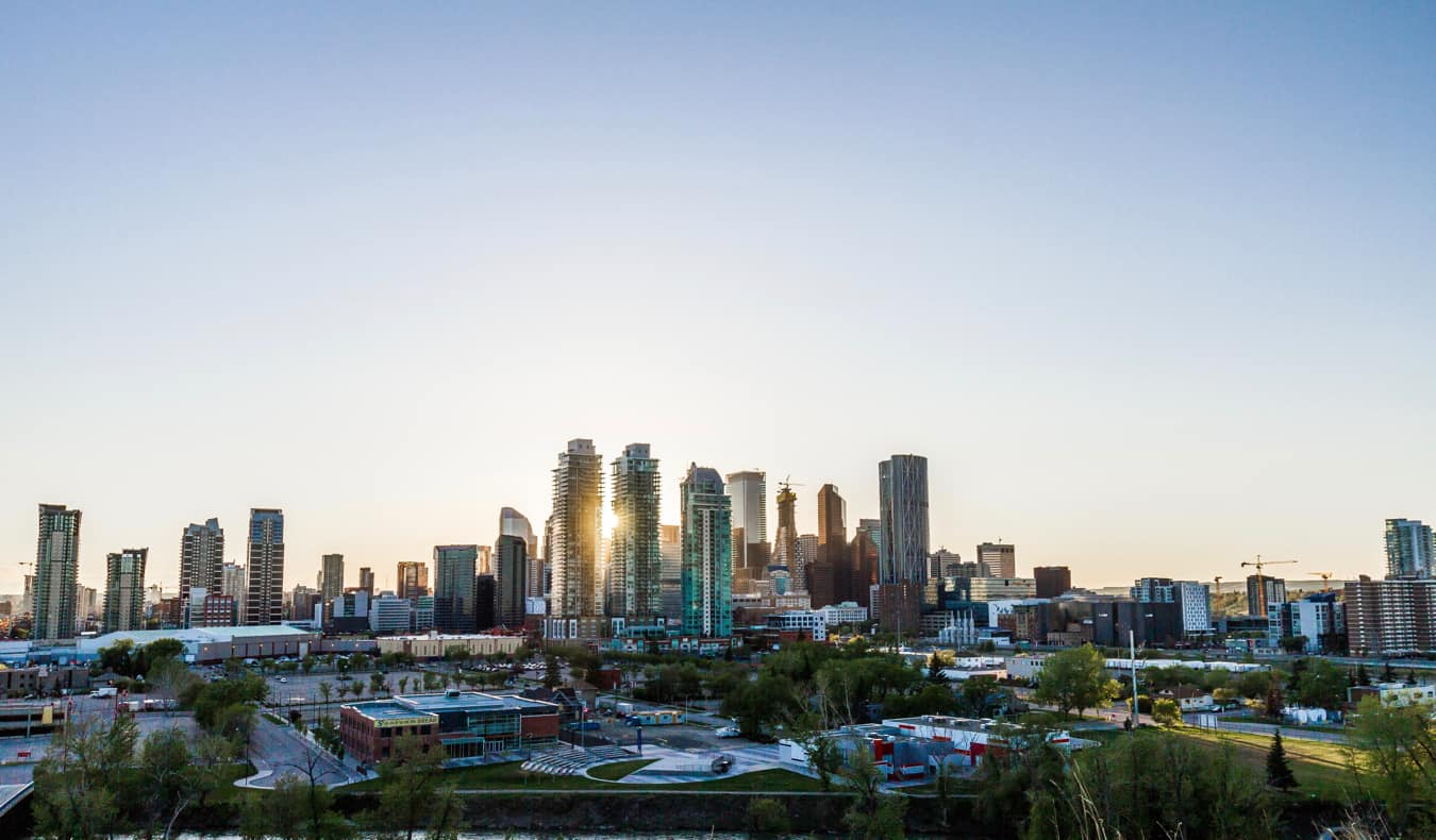 The towering skyline of Calgary, Alberta during sunset