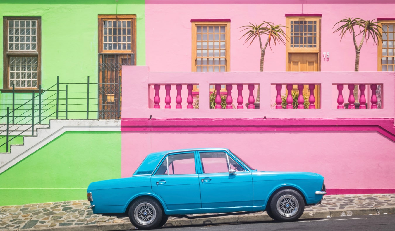 A parked car in the colorful Bo-Kaap neighborhood of Cape Town, South Africa