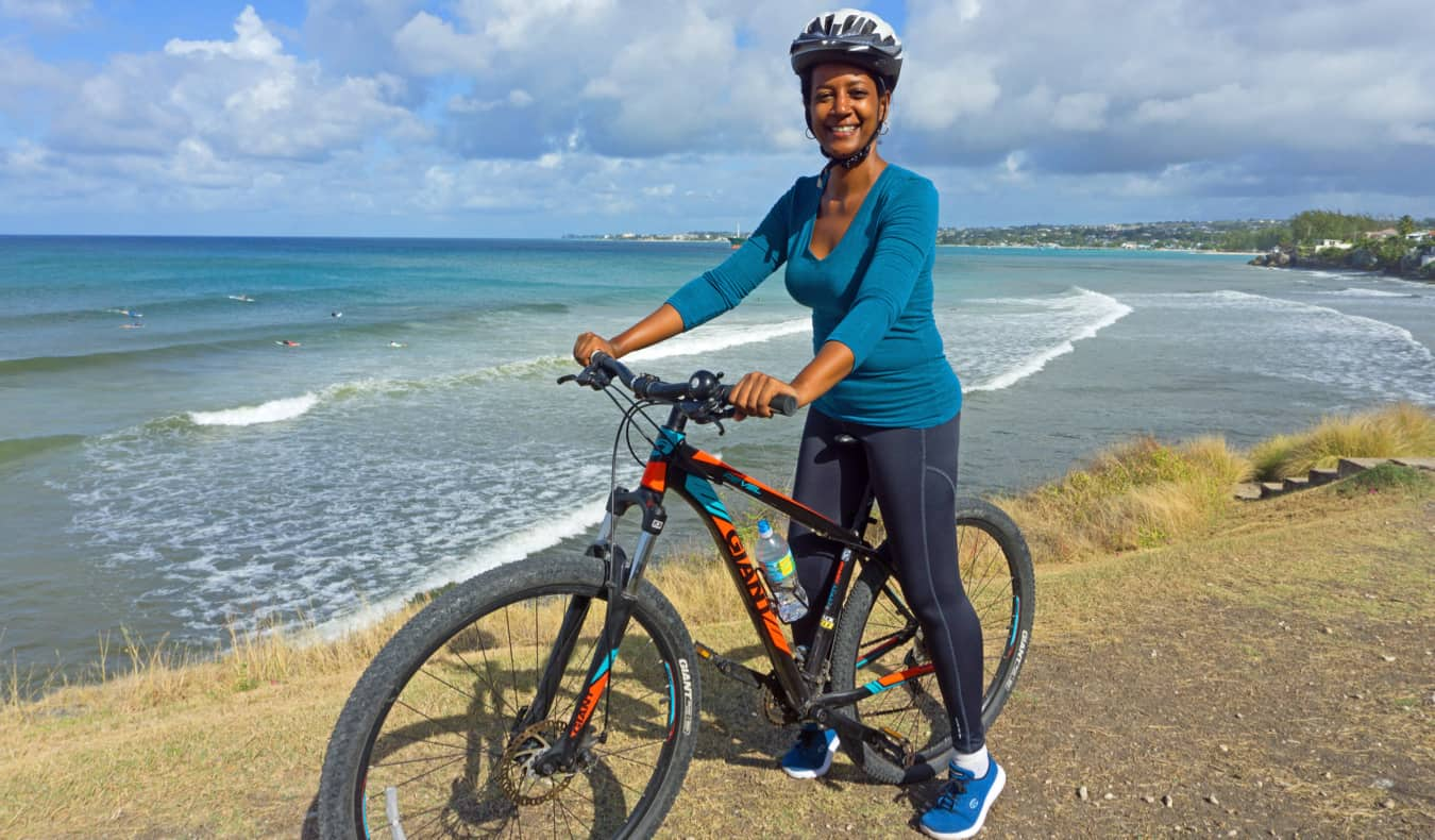 Lily Girma, a travel writer, cycling in the Caribbean