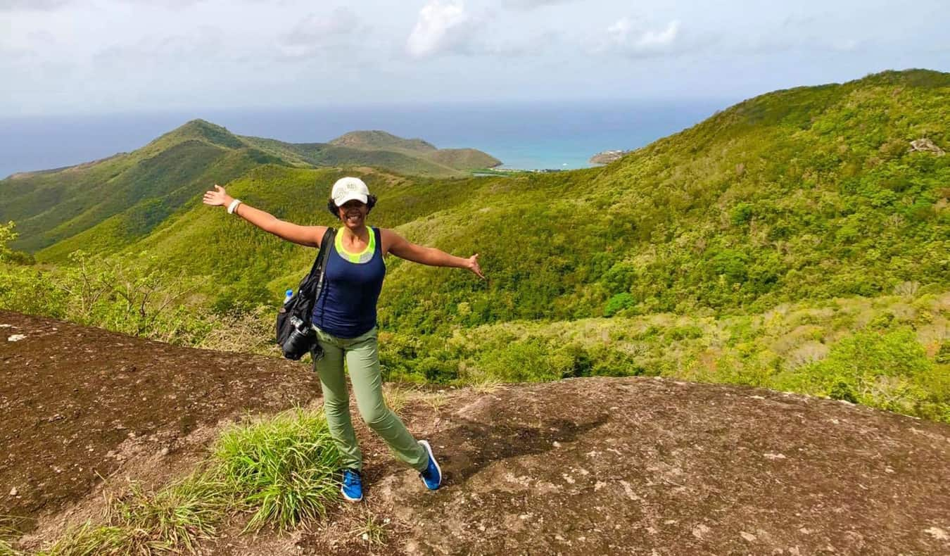 Lily Girma, a travel writer, hiking in the Caribbean