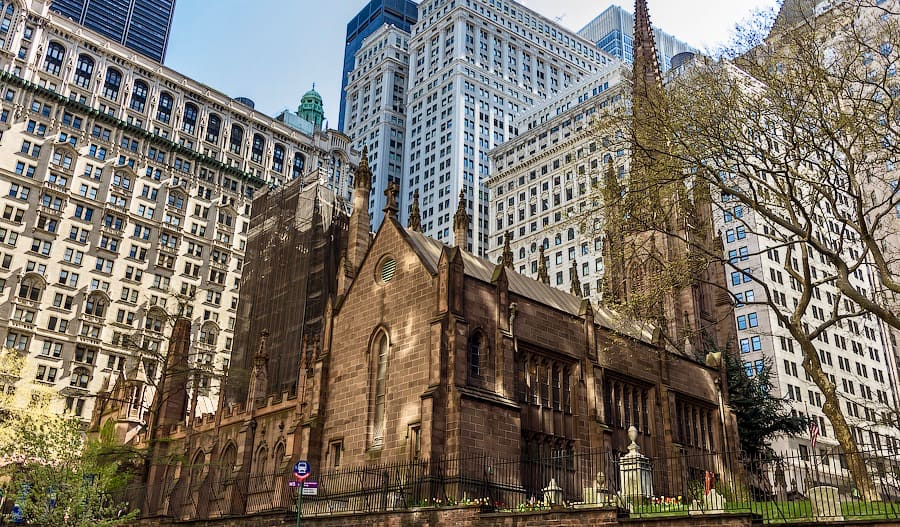 The historic Trinity Church surrounded by skyscrapers in New York, USA