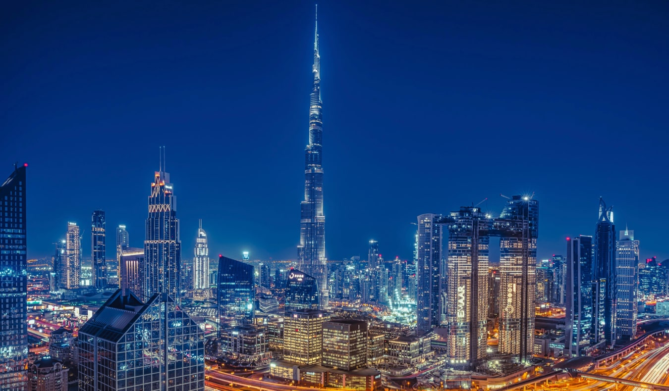 The towering and modern skyline of Dubai at night with the Burj Khalifa