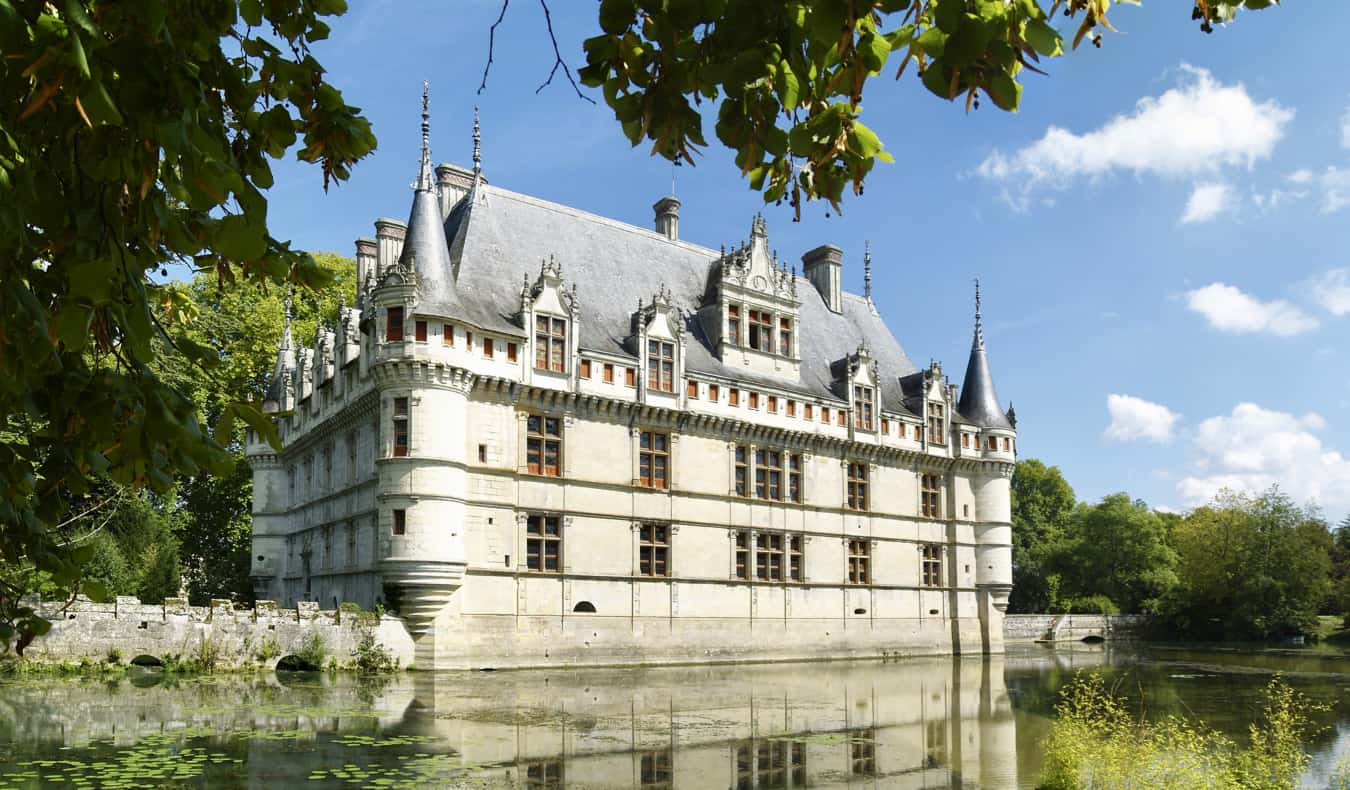 The Azay le Rideau chateau surrounded by a man-made lake in France during the summer