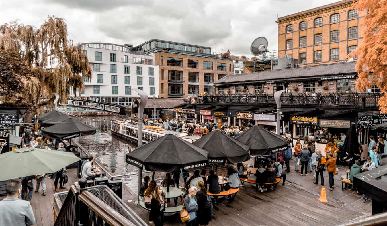 People walking and eating at Camden market in London, England