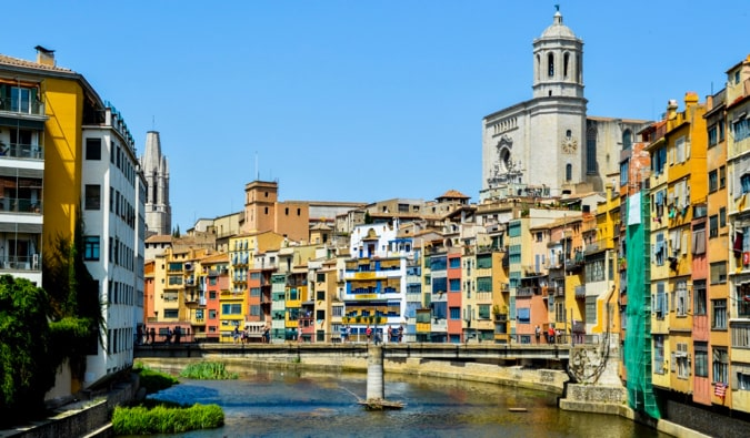 The colorful buildings of Girona, Spain overlooking a river