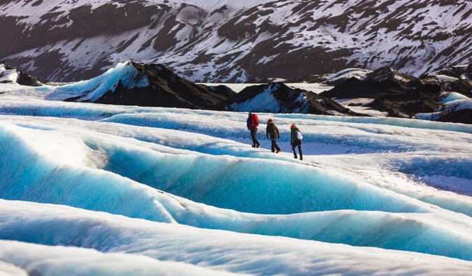 A group of travelers hiking on a glacier in Iceland