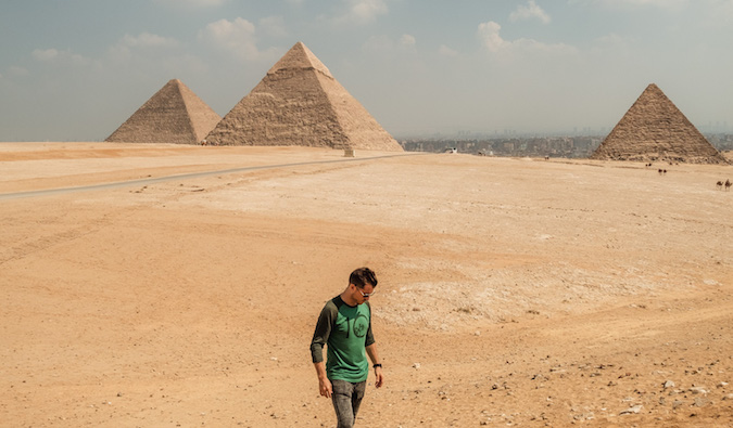 Jeremy Scott Foster posing near the pyramids in Egypt