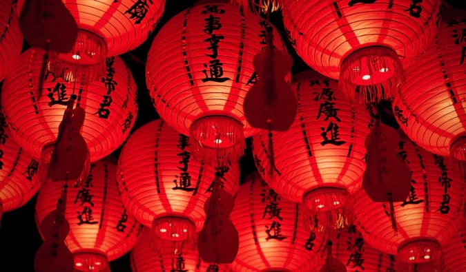 Red lanterns at night with Chinese characters on them