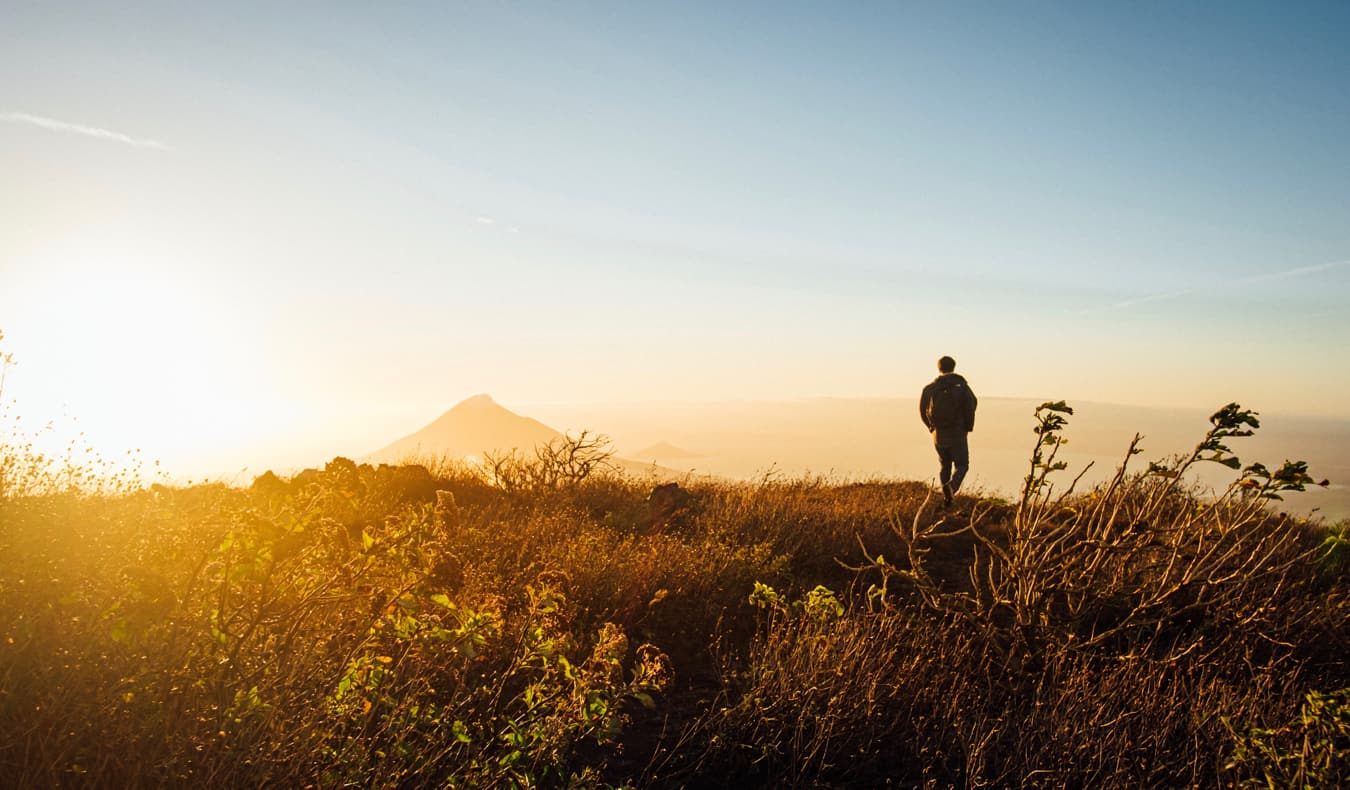 A man hiking in the mountains near Leon, Nicaragua