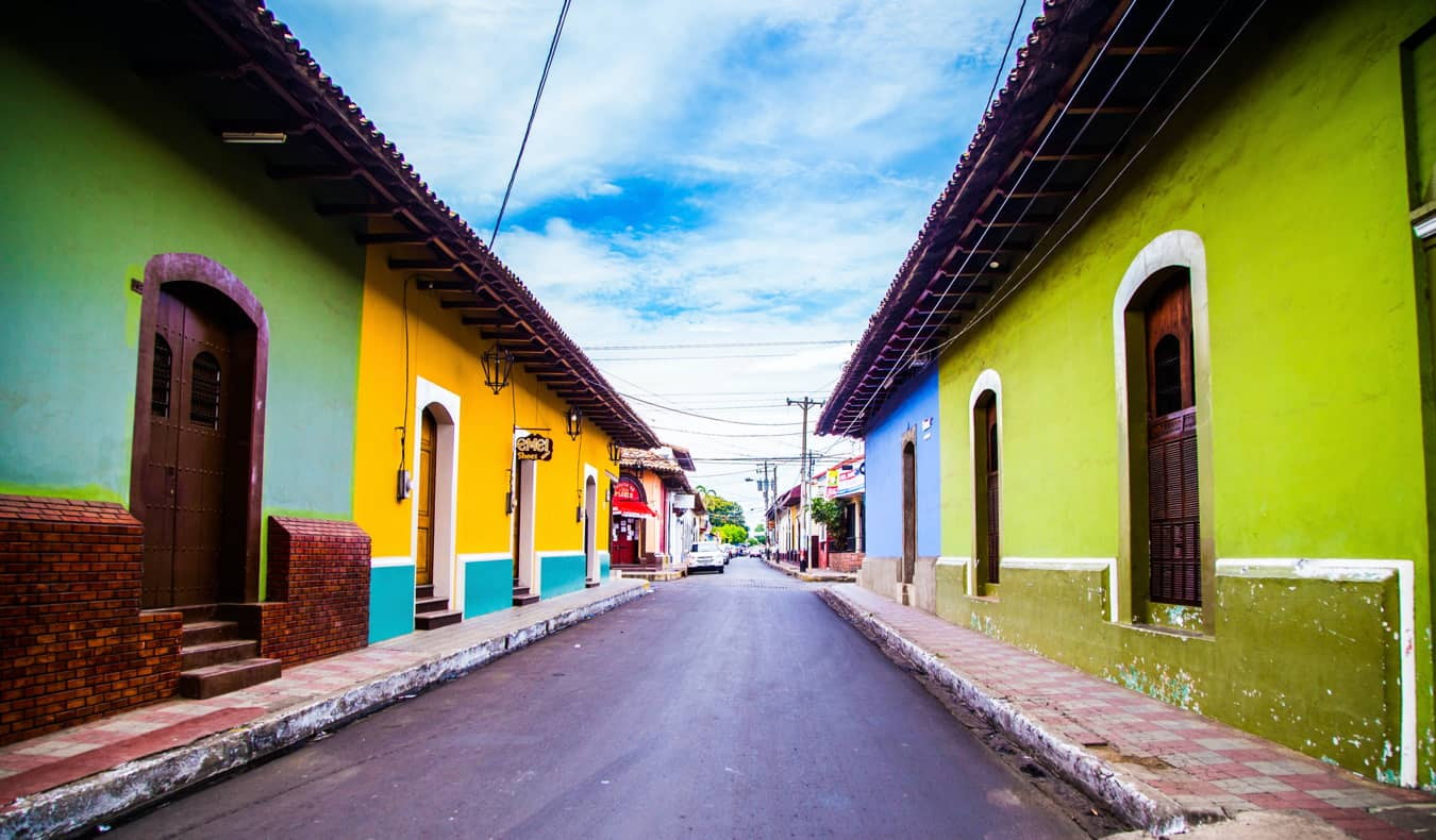 Colorful buildings along a narrow street in Leon, Nicaragua