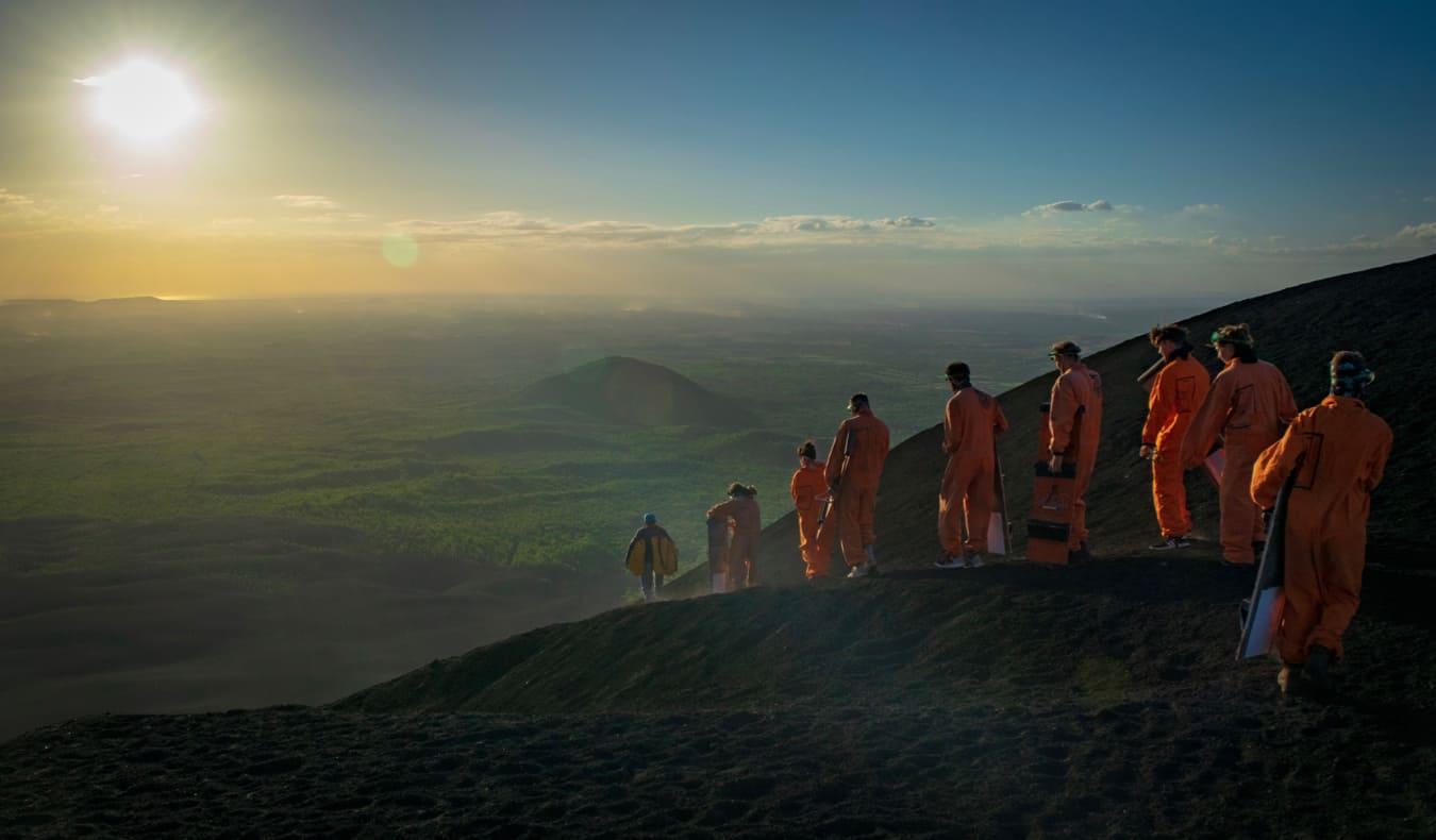 A group of people volcano boarding near Leon, Nicaragua