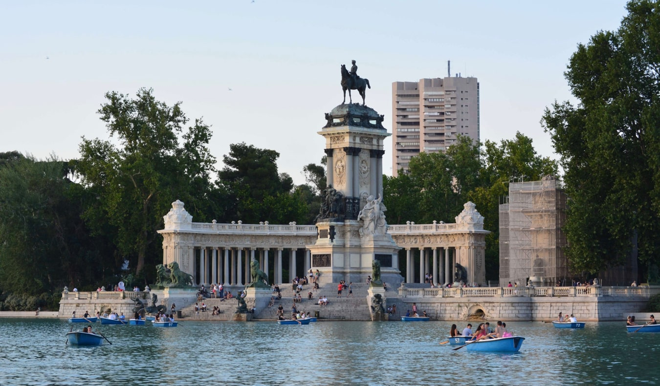 People in rowboats on the lake in El Retiro Park in Madrid, Spain