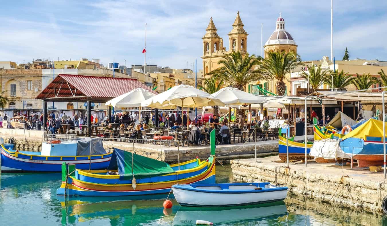 Boats on the water near the shore of Valletta, Malta