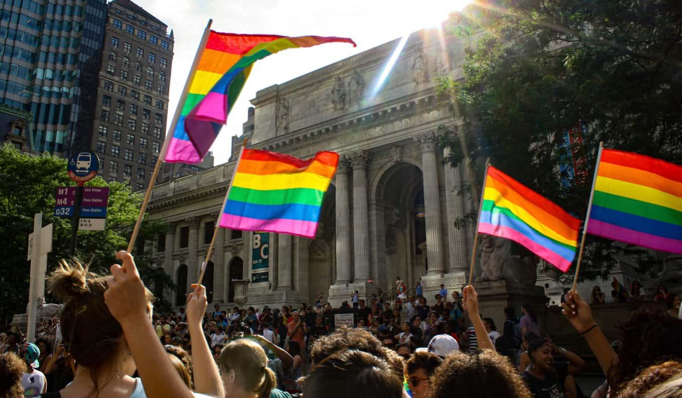 People waving gay pride flags during Pride in NYC, USA