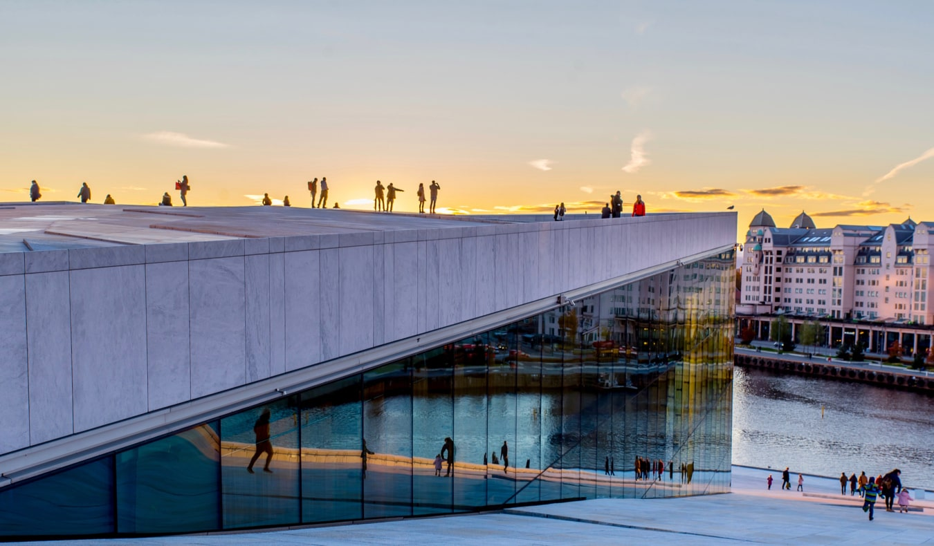 The famous Oslo Opera House in Norway overlooking the city at sunset