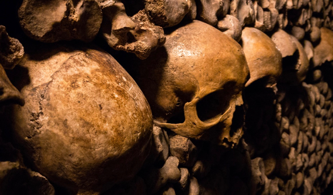 The old bones and skulls of the dark Catacombs in Paris, France