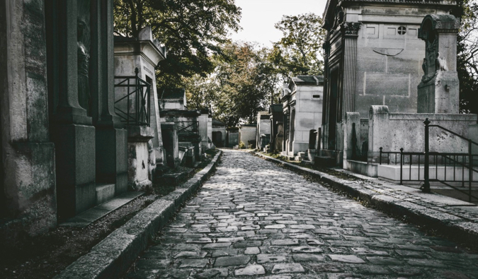 The cobblestones and mausoleums of the Pere Lachaise cemetery in Paris, France