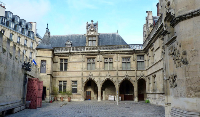 The historic stone exterior of the Cluny Museum in Paris, France