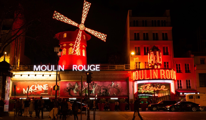 The famous Moulin Rouge at night in Paris, France