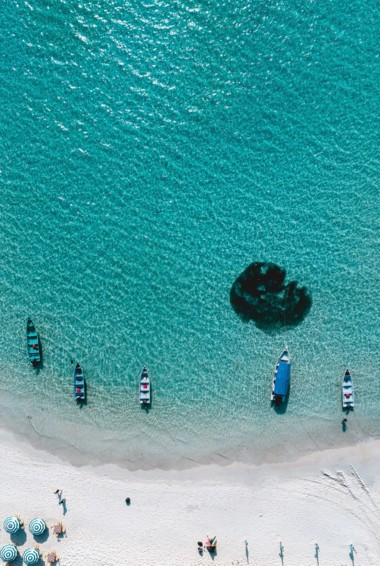 A beautiful beach and clear waters of the Perhentian Islands, Malaysia