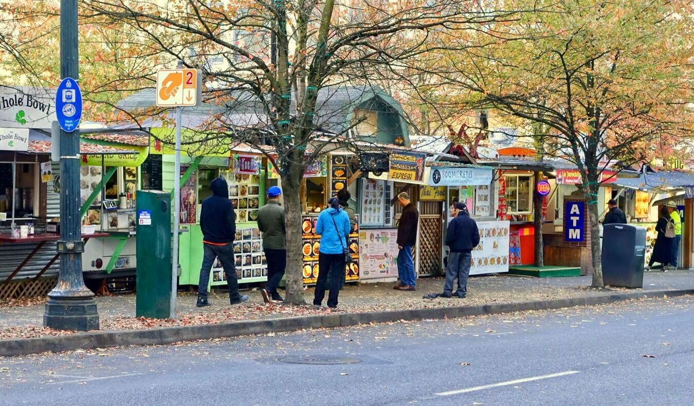 A line of food trucks and street food stalls in Portland, Oregon