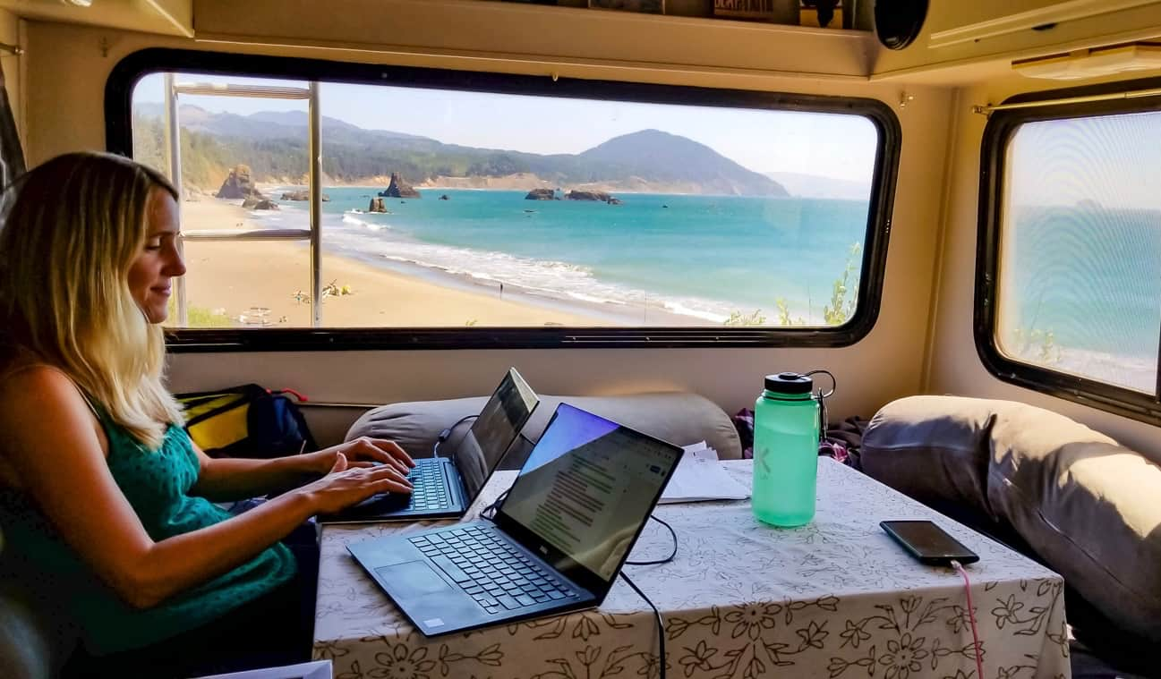 Anne from HoneyTrek working on a laptop in her RV