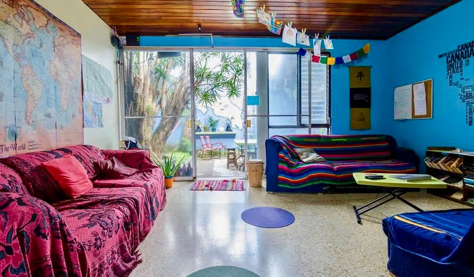 The chill common room with colorful couches at In the Wind Hostel in San José, Costa Rica